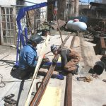 fabrication in process, individually welded steel bi-product, 37' x 7' x 7', 2009