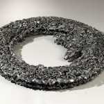"""Paula Castillo Sculpture: """"floating O,"""" steel, 31 x 31 x 3 inches, 2001. New Mexico"""