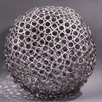 """Paula Castillo Sculpture: """"bola,"""" cut steel pipe, 26 x 26 x 4 inches, 2001. New Mexico"""