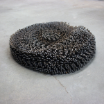 "PAULA CASTILLO SCULPTURE: ""all those portions of small waves,"" individually welded steel bi product, 27"" x 27"" x 3"", 2012"